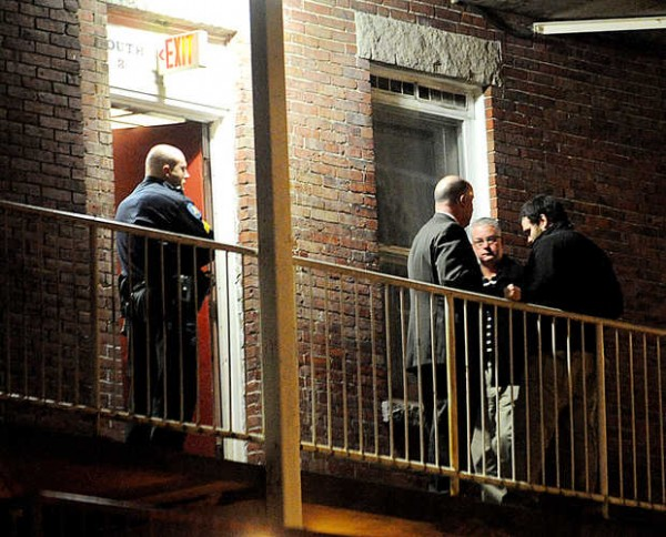Lewiston and Maine State Police appeared to collect evidence from a possible stairwell or hallway marked with an exit sign and the words &quotSouth 3&quot at 64 Oxford St. after the body of a woman was found Wednesday.