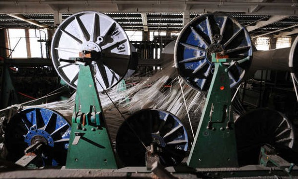 Textile equipment at rest in Bates Mill No. 5.