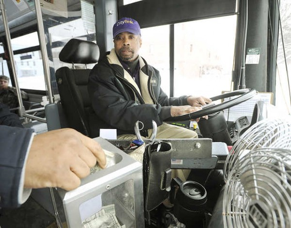 City Link bus driver Lerry Holloman monitors the fare box as passengers board his bus on Wednesday.