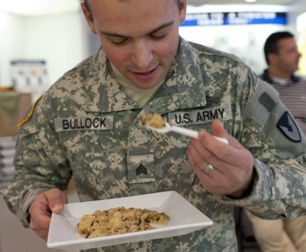 Army Sgt. Seth Bullock taste-tests the chicken and rice portion of an MRE at the Natick Soldier Research, Development & Engineering Center, just outside Boston.