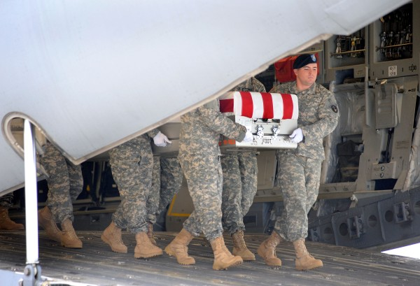 An Army carry team moves a transfer case containing the remains of Sgt. 1st Class Johnathan B. McCain at Dover Air Force Base in Delaware on Tuesday, Nov. 15, 2011. According to the Department of Defense, McCain, 38, of Apache Junction, Ariz., died Nov.13, 2011 in Kandahar province, Afghanistan, of injuries sustained after encountering an improvised explosive device while on mounted patrol.