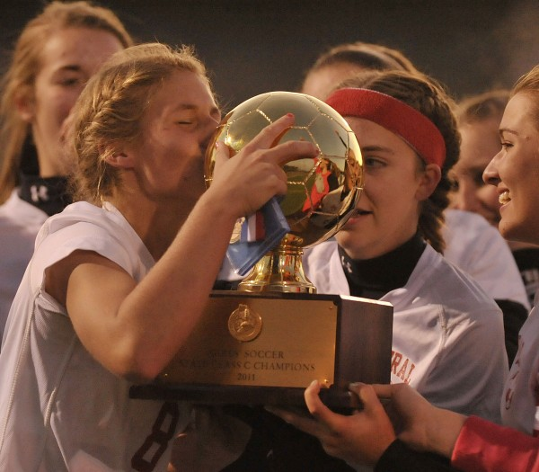 Central's Mackenzie McHugh kisses the gold ball trophy after her team defeated St. Dominic's 2-1 in double overtime to win the State Class C championship in Hampden, Maine Saturday Nov. 5, 2011.
