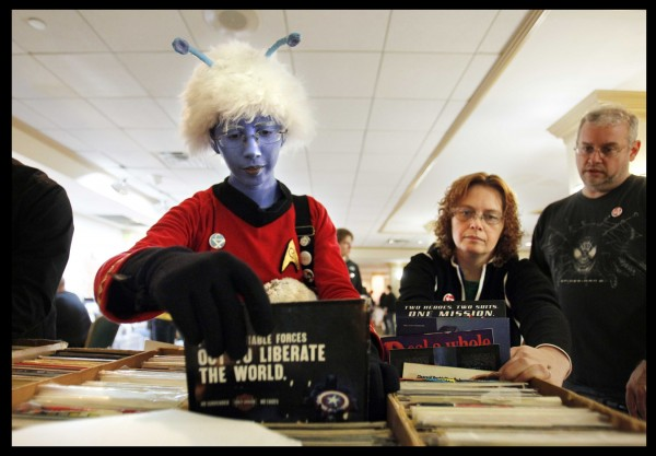 Juliana Lawrence of Portland, dressed as an Andorian from Star Trek, sorts through boxes of used comics at the Coast City Comicon in Portland last weekend.
