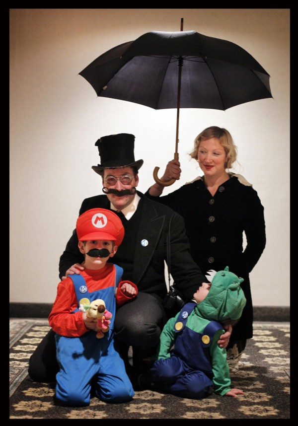 Matt Barter, dressed as Dr. Livingtston, his wife Rebekah, playing the role of Livingston's &quotlovely assistant&quot and their kids Milo, 7, as Mario, and Oliver, 3, as Luigi, pose during Coast City Comicon in Portland. The Barter's live in Richmond.