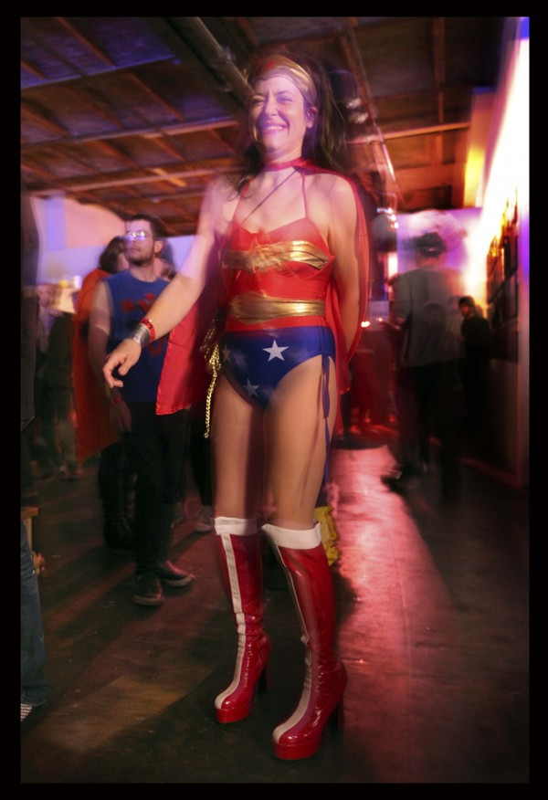 A Wonder Woman fan dances at the Nerd Rave last Friday night at SPACE Gallery during Coast City Comicon in Portland.