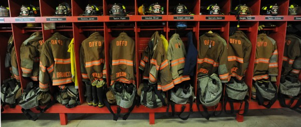 A line of firefighters' lockers filled with gear is seen at the Dover Fire station on Wednesday. Michael Curtis' gear once filled one of these lockers.
