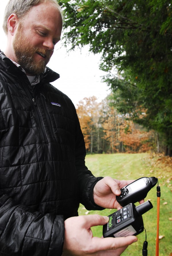 Chip Noble, product and design manager at DeLorme in Yarmouth, demonstrates the use of his company's new inReach text communicator.