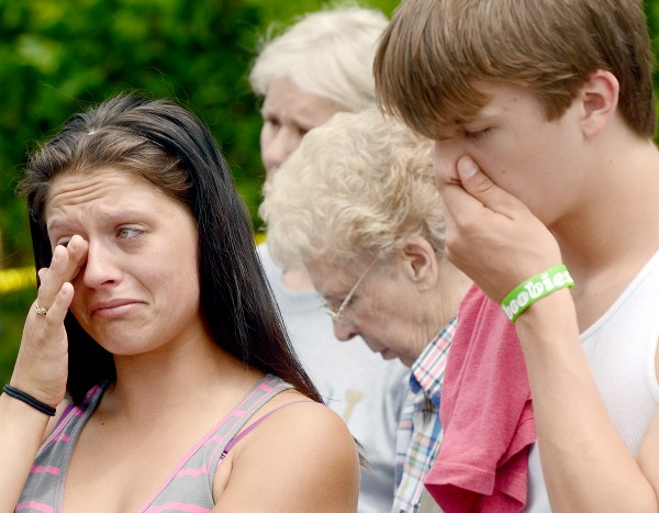 Randi Butterfield (left) and Zack Butterfield break down in Farmington in June 2011 during a plea for public help to find the person responsible for the death of their grandmother, Grace Burton.