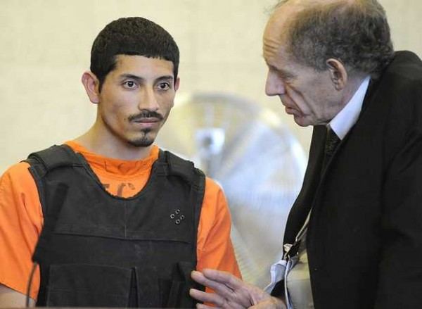 Juan A. Contreras, 27 of Waltham, Mass., listen as his court-appointed attorney, David Sanders (right), talks to him during an initial appearance in Franklin County Superior Court on Nov. 21, 2011.