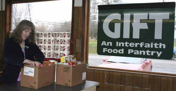 Michele Lombard-Fowler, president of the Grace Interfaith Food Table board of directors, packs a food box in the organization's new, larger facility located at the former Industrial Street One-Stop at 11 Industrial St. in Presque Isle. With nearly twice the square footage as the previous location, Lombard-Fowler said the additional space makes a world of difference.