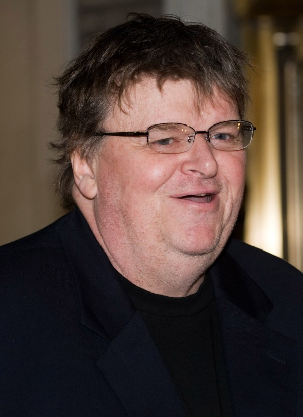 Documentary film maker Michael Moore arrives at the opening night performance of the Broadway play &quotA Behanding in Spokane&quot in New York on March 4, 2010.