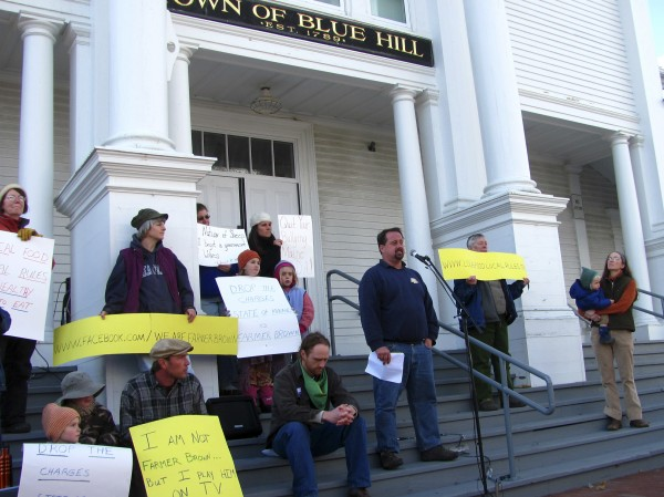 Dan Brown, owner of Gravelwood Farm in Blue Hill, speaks to a crowd of more than 150 people gathered Friday, Nov. 18, 2011, in front of the Blue Hill Town Hall. The Maine Department of Agriculture has filed a suit against Brown, alleging that he is illegally selling unpasteurized milk without a license. Brown, meanwhile, insists he is doing nothing wrong and that a local food ordinance adopted by Blue Hill residents protects the rights of farmers to sell directly to consumers without a license.