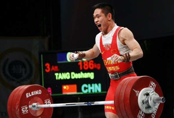 Tang Deshang from China reacts as he competes to win the gold medal in the Men's 69 kg category at the World Weightlifting Championships, in Paris, Tuesday Nov. 8, 2011.