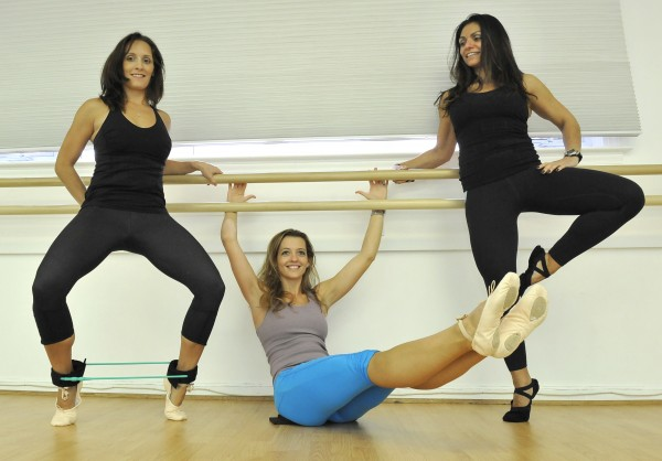 From left, Alyssa Adams, Reina Offutt Pratt and Mary Farber demonstrate ballet moves used in a barre fitness class at Potomac Pilates in Potomac, Md. Adams is doing a plie, which tones calves, and the resistance band around her ankles works the outer thighs. Pratt is modifying the teaser Pilates move by holding the barre. Farber's tendu position strengthens the leg and builds flexibility.