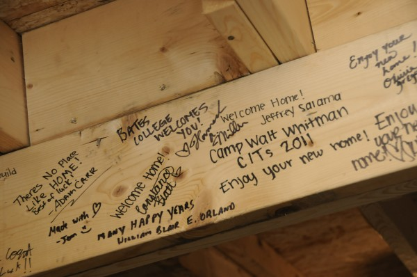 Various volunteers signed floor joists in the basement at the Hooker family's new Habitat for Humanity-built home on Milford Street in Bangor. A dedication ceremony and celebration for the family took place at the home Saturday afternoon, Nov. 19, 2011.