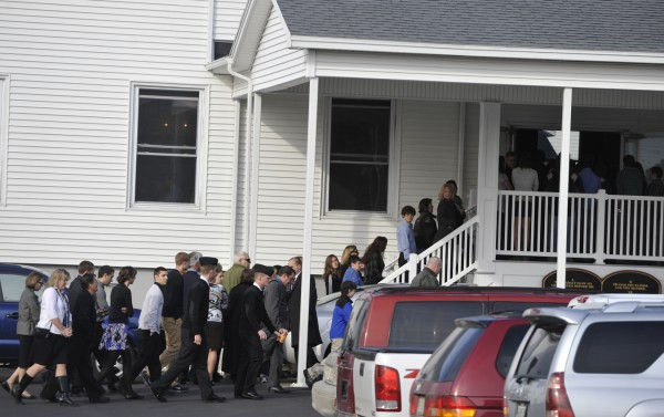 Hundreds of friends and family line up to enter Hermon Baptist Church Saturday, Nov. 12, 2011 for the memorial services for James C. McPhearson III and Richard A. Picken Jr.