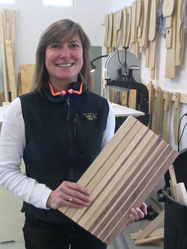 In addition to the Adirondack furniture she makes with her husband Clive, Odi Brown crafts intricate cutting boards from such fine woods as cherry and maple.