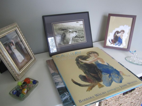 "A table top in Barbara Walsh's home office holds a ""Sammy in the Sky"" book and a photo of the original old hound dog, Sammy."