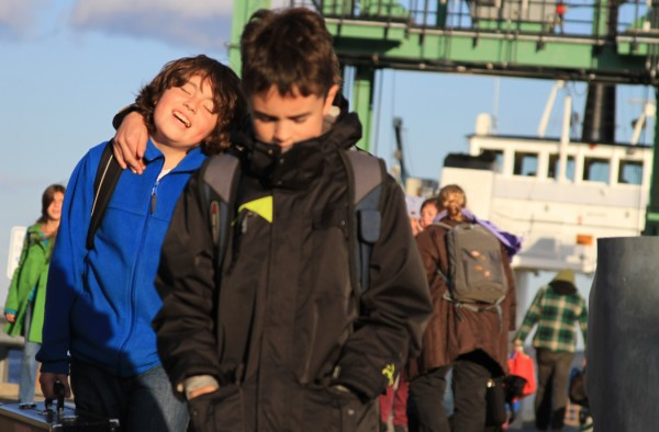 After a long day at school, Isleboro magnet students step off the ferry into the afternoon light on the mainland.