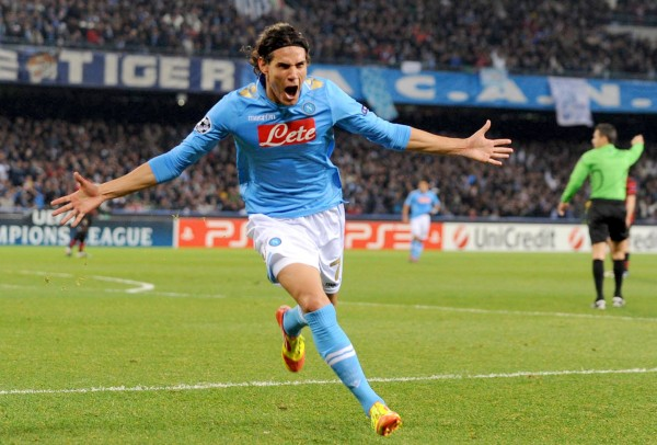 Napoli's striker Edinson Cavani, of Uruguay, celebrates after scoring during the Champions League, group A soccer match between Napoli and Manchester City, at the San Paolo stadium in Naples, Italy on Tuesday, Nov. 22, 2011.