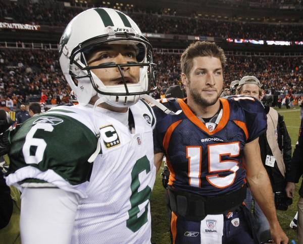 New York Jets quarterback Mark Sanchez (6) and Denver Broncos quarterback Tim Tebow (15) walk off the field together after an NFL football game Thursday, Nov. 17, 2011, in Denver. The Broncos won 17-13.