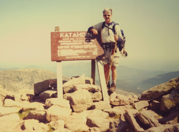 Nelson Daigle stands atop Mount Katahdin in Maine in August 2003. Daigle has hiked Maine's tallest mountain more than 400 times and has been hiking it for only 17 years. He has plenty of worn-out hiking boots to prove it.