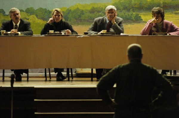 Members of the Land Use Regulation Commission, including (from left) James A. Nadeau, commission director Catherine M. Carroll, commission chair E. Bart Harvey and Gwendolyn Hilton, listen to one of nearly 150 concerned residents voice an opinion about the Plum Creek development plan during a public hearing at Greenville High School in 2008.