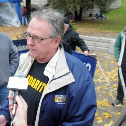 Eastern Maine Labor Council president Jack McKay (right), vice president Emery Deabay (center) and Scott Cuddy of IBEW 1253 were among the people who spoke at a press conference to express their support for Occupy Bangor. The event was held at Peirce Park near the Occupy Bangor encampment Friday.