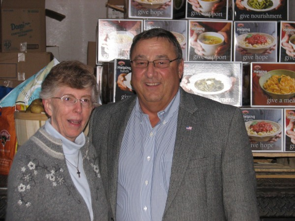 Sister Lucille MacDonald, administrator of Emmaus Homeless Shelter in Ellsworth, stands next to Gov. Paul LePage in front of a truckload of food being delivered Thursday to the shelter. The food was collected recently by LePage at his official residence in Augusta and donated by Hannaford supermarket chain.