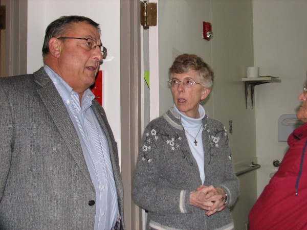 Gov. Paul LePage gets a tour of the Emmaus Homeless Shleter in Ellsworth on Thursday afternoon from Sister Lucille MacDonald, administrator of the shelter. LePage helped deliver several hundred pounds of food collected at the Blaine House in Augusta, plus 50 boxes of additional food donated by Hannaford supermarket chain, to the shelter prior to hosting a town hall-style meeting Thursday night at Ellsworth Elementary-Middle School.