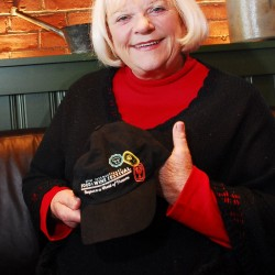 Linda Bean holds a hat from The Epcot International Food and Wine Festival at Walt Disney World Resort in Florida which features a lobster in her Freeport restaurant in October 2011.