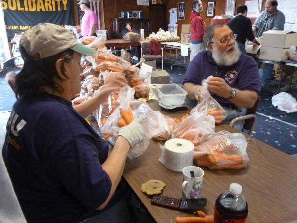 Loren and Sandy Snow (foreground) of Surry help package food for Thanksgiving baskets on Saturday, Nov. 19, 2011 at the Solidarity Center in Brewer.