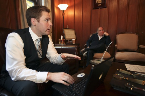 Nathan Raab (left) and his father Steven Raab listen to digital recordings of their White House communications tapes made in the immediate aftermath of President John F. Kennedy's assassination involving Air Force One in flight from Dallas on November 22, 1963, at their office, in Philadelphia, on Wednesday Nov. 9, 2011, during an interview.