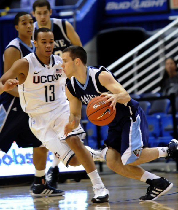 Connecticut's Shabazz Napier guards Maine's Andrew Rogers during the first half  in Hartford, Conn., Thursday, Nov. 17, 2011.