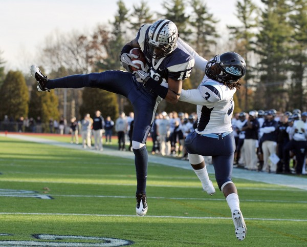 New Hampshire receiver R.J. Harris (15) catches a touchdown pass ahead of Maine defensive back Trevor Coston (3) during the fourth quarter of a NCAA college football game at Cowell Stadium in Durham, N.H., Saturday, Nov. 19, 2011. New Hampshire defeated Maine 30-27.