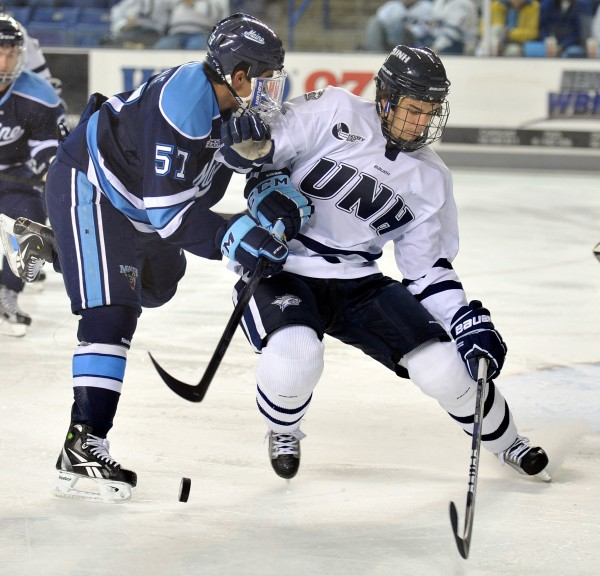 New Hampshire defenseman Trevor van Riemsdyk (right) keeps the puck from Maine defenseman Matt Mangene during the first period of a NCAA college hockey game at the Whittemore Center Arena in Durham, N.H., Saturday, Nov. 5, 2011.