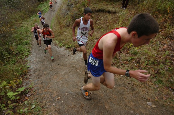 Bangor High School's Nate Ivey, second from right, and other harriers power up one of the final hills near the end of their Maine Eastern Regional Cross-Country championship race in Belfast Saturday, Oct. 22, 2011.
