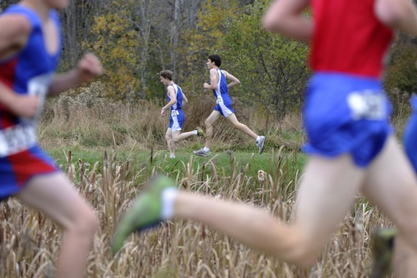 Near the one-mile mark, runners circle the pond behind Troy Howard Middle School during a Eastern Regional Cross-Country Championship race in Belfast Oct. 22, 2011.