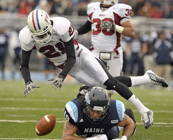 Massachusetts' Kirk Nelms  (21) collides with Maine receiver Jeff Falvey (19) after Falvey's missed reception in the first half of an NCAA college football game in Orono, Maine Saturday, Nov.12, 2011.
