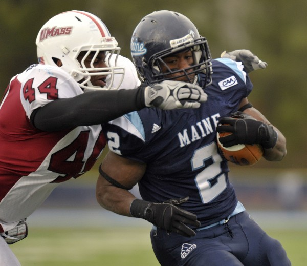 Massachusetts' Perry McIntyre (44) gets a collar on Maine running back Pushaun Brown (2) but couldn't prevent a touchdown for Maine in the first half of an NCAA football game in Orono, Maine Saturday, Nov.12, 2011.
