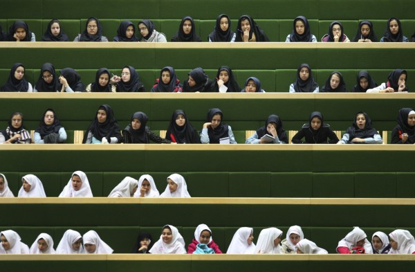 Iranian school girls follow the debates of the parliament during the impeachment of Economy Minister, Shamsoddin Hosseini (not pictured) in Tehran, Iran on Tuesday, Nov. 1, 2011. Iran's economy minister survived an impeachment vote in parliament after appeals by President Mahmoud Ahmadinejad to keep the government intact despite anger over a major banking scandal. Lawmakers voted 141-93 on Tuesday to keep Shamsoddin Hosseini, who has been accused of failing to take action after learning of the alleged $2.6 billion bank fraud.