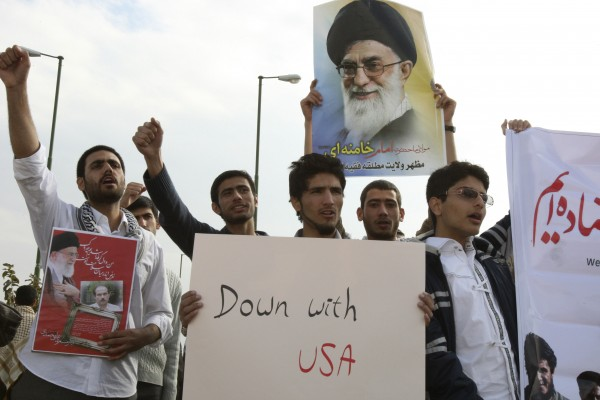 Iranian students chant slogans and hold an anti-U.S. placard and a poster of supreme leader Ayatollah Ali Khamenei, as they gather in front of the Isfahan Uranium Conversion Facility in support of Iran's nuclear program, just outside the city of Isfahan 255 miles south of the capital Tehran, Iran, Tuesday, Nov. 15, 2011.