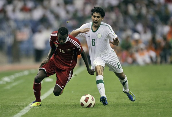Saudi Arabia's Ahmed Otaif (right) fights for the ball against Oman's Fawzi Bashir during their 2014 FIFA World Cup Asia qualifying soccer match at King Fahd stadium in Riyadh, Saudi Arabia on Tuesday, Nov. 15, 2011.