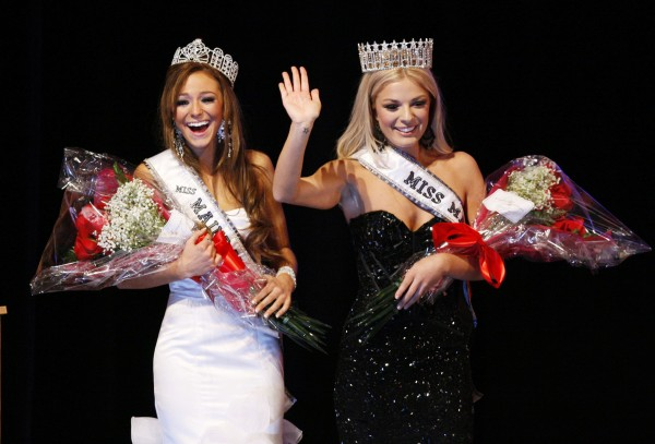 Miss Teen Maine Molly Fitzpatrick (left) and Miss Maine Rani Williamson acknowledge applause after winning their pageants, Sunday, Nov. 20, 2011, in Westbrook.