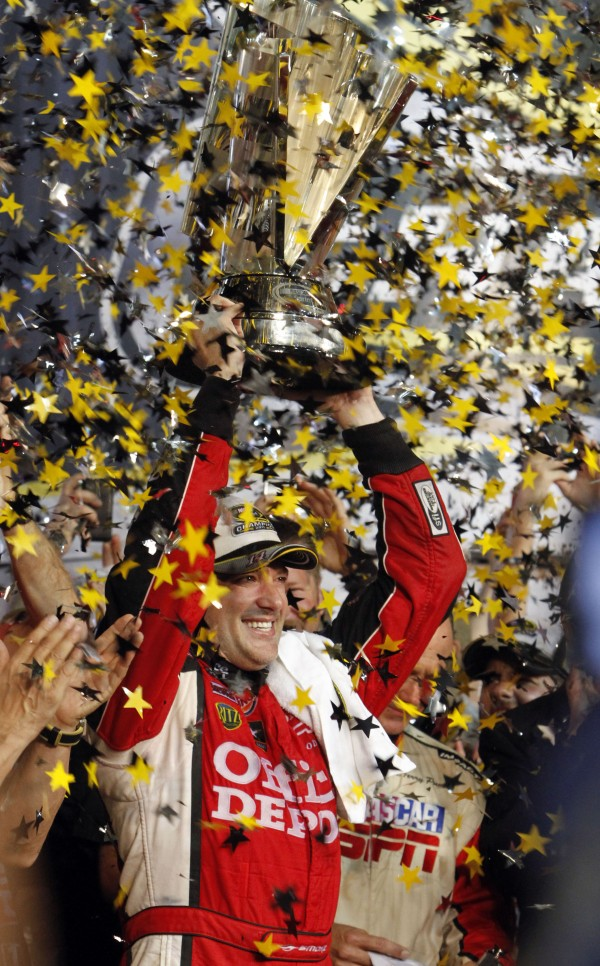 Tony Stewart raises the series championship trophy after winning the NASCAR Sprint Cup Series auto race and clinching the series championship, at Homestead-Miami Speedway in Homestead, Fla., on Nov. 20, 2011. NASCAR opened its season with a fresh-faced Daytona 500 winner and ended it with one of the most thrilling championship race in series history.