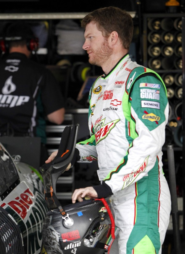 Dale Earnhardt Jr. prepares to get into his car during a NASCAR Sprint Cup auto racing practice at Phoenix International Raceway, Friday, Nov. 11, 2011, in Avondale, Ariz.