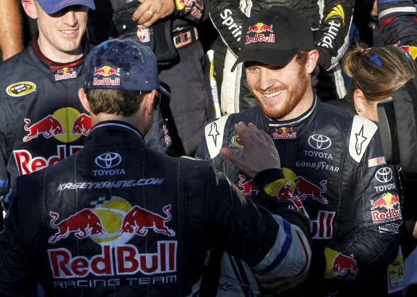 Kasey Kahne (left) celebrates his win in Victory Lane with Brian Vickers after Kahne won the NASCAR Sprint Cup Series auto race at Phoenix International Raceway, Sunday, Nov. 13, 2011, in Avondale, Ariz.