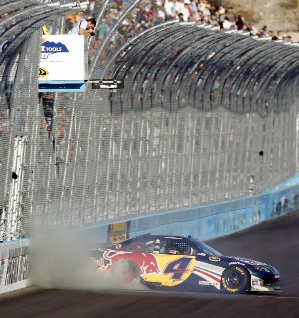 Kasey Kahne does a burnout along the finish line after winning the NASCAR Sprint Cup auto race at Phoenix International Raceway on Sunday, Nov. 13, 2011, in Avondale, Ariz.