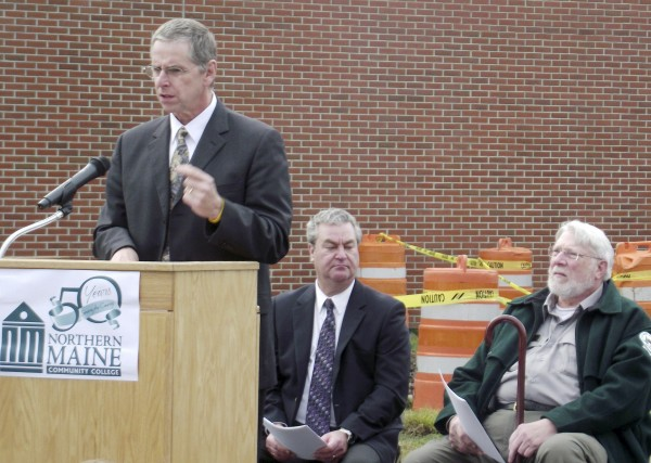 Tim Crowley, president of Northern Maine Community College, speaks at the groundbreaking ceremony for the installation of a 900 kilowatt biomass boiler on the campus on Monday, Nov. 14, 2011. Approximately 20 people attended the 15-minute ceremony at NMCC. The boiler will provide heat for nearly 70 percent of the square footage of campus buildings.