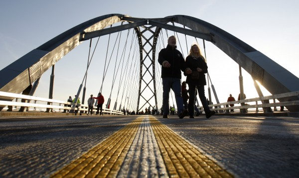 Pedestrians walk across the Lake Champlain Bridge after a dedication ceremony in Crown Point, N.Y., on Monday, Nov. 7, 2011. The original span was closed in October 2009 after inspectors deemed it unsafe. The 80-year-old bridge was destroyed by a controlled explosion in late December 2009.The new bridge reconnects Crown Point, N.Y. and West Addison, Vt.